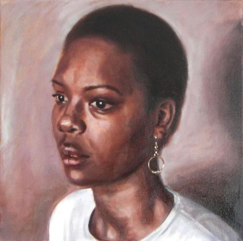 portrait of woman wearing gold earrings