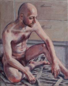 figure study of male nude on floor