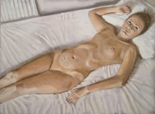 nude woman lying on bed